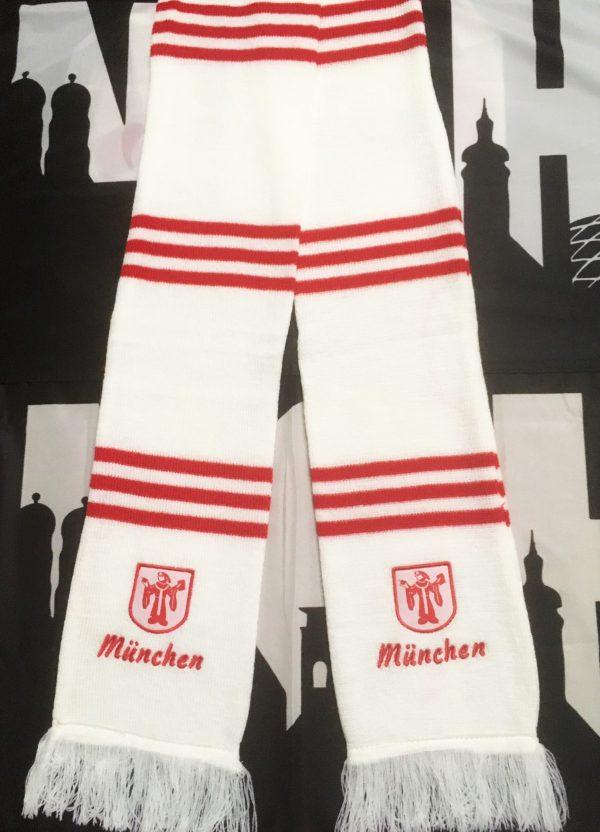 """Balkenschal """"Münchner Kindl"""" Der neue Balkenschal """"Münchner Kindl"""" ist ein weißer Schal mit roten Balken. An den Schalenden ist ein schönes Münchener Kindl und der Schriftzug München in rot eingestickt. Material 100% Acr"""